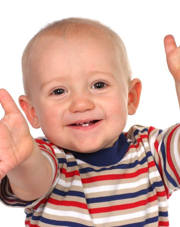 Bébé atteignant pour le visualisateur photo stock
