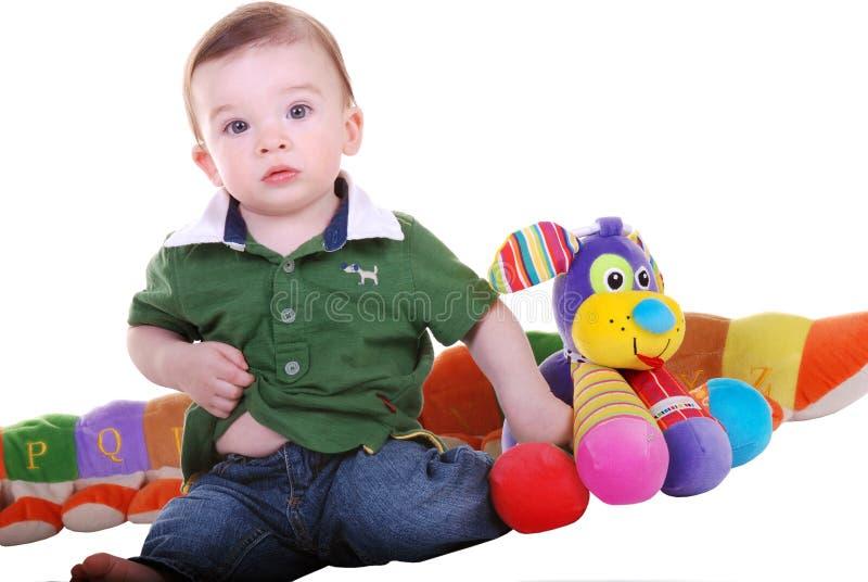 Bébé avec des jouets. image libre de droits