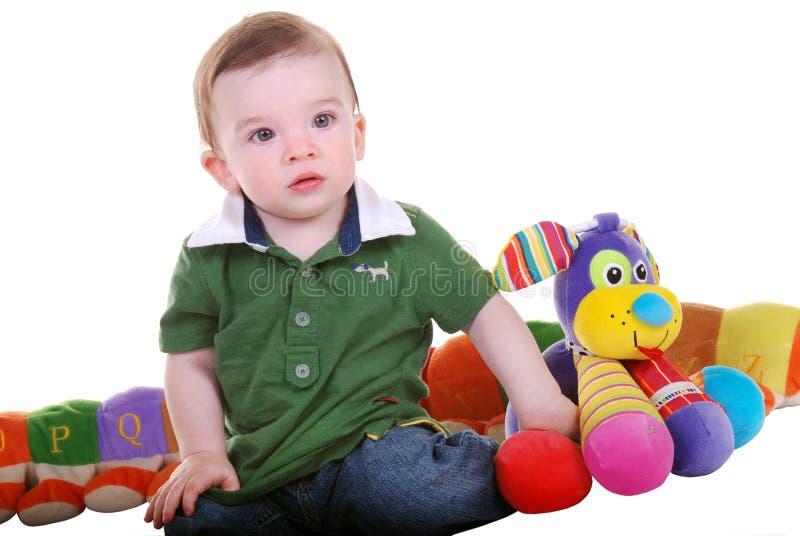 Bébé avec des jouets. image stock