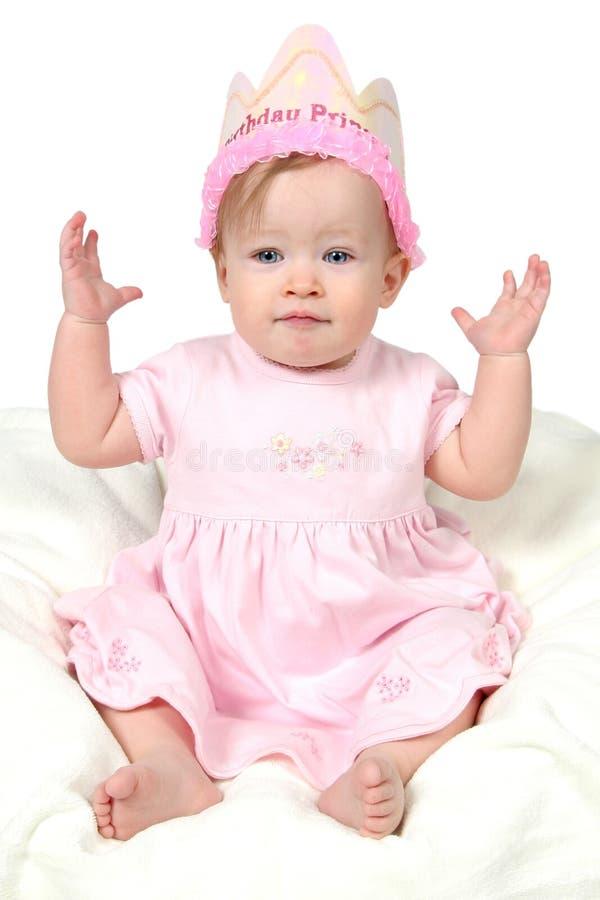 Bébé avec le chapeau d'anniversaire photos stock