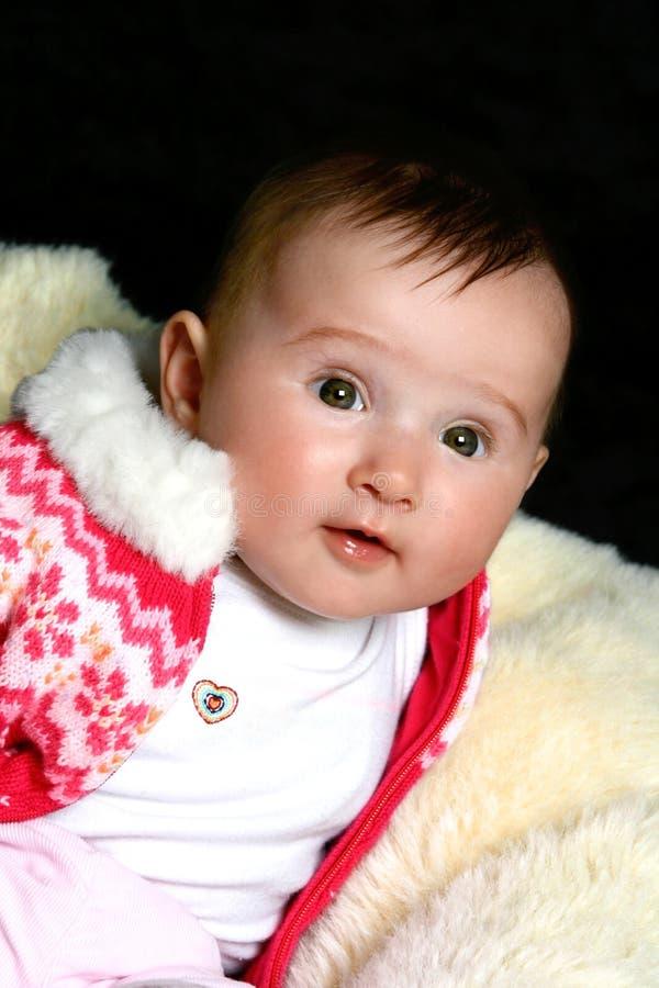 Bébé dans le cavalier rose photographie stock