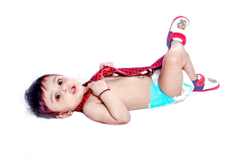 bébé garçon indien avec le lien images libres de droits