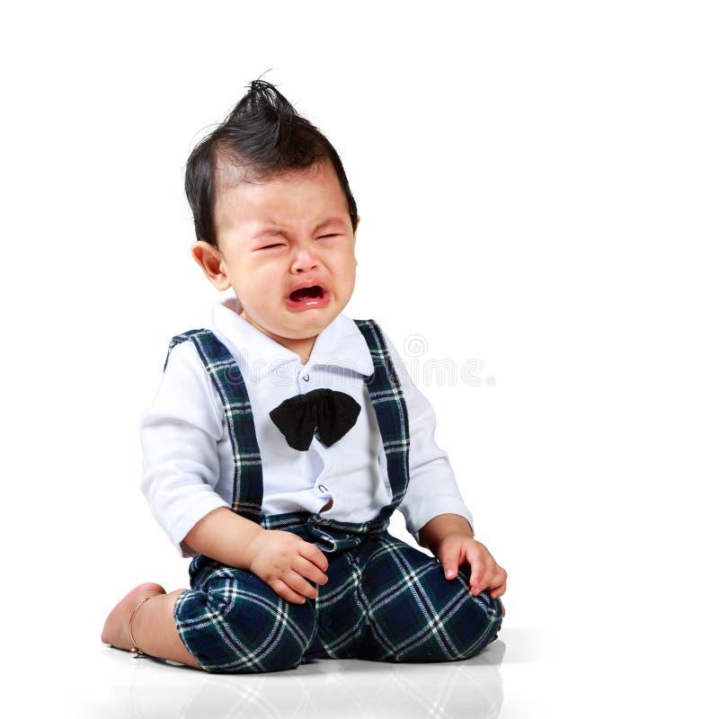 Bébé garçon pleurant image stock