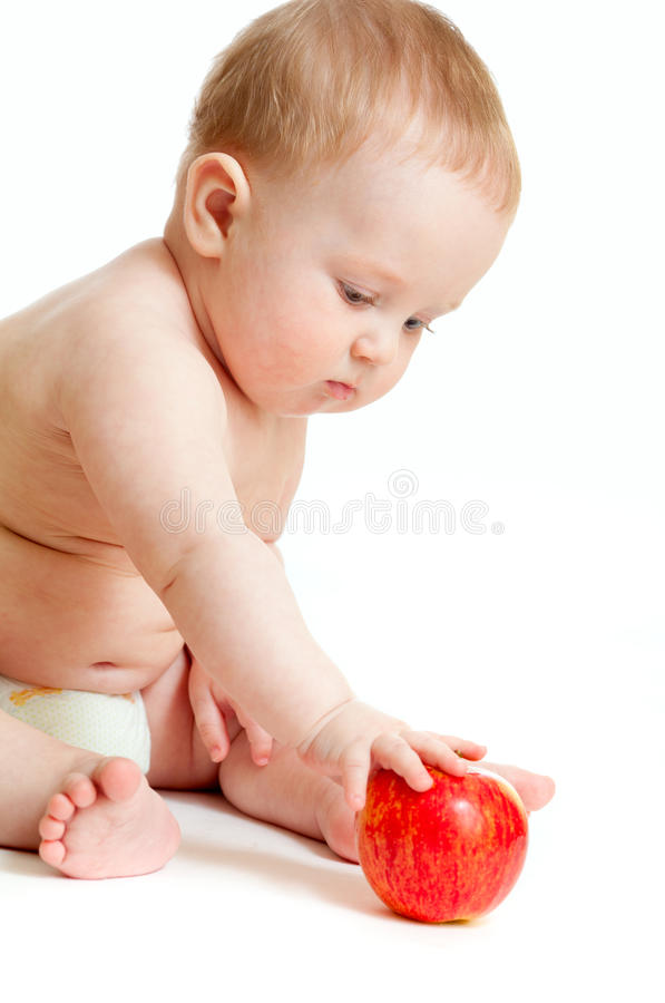 Bébé mangeant de la nourriture saine d'isolement photos libres de droits