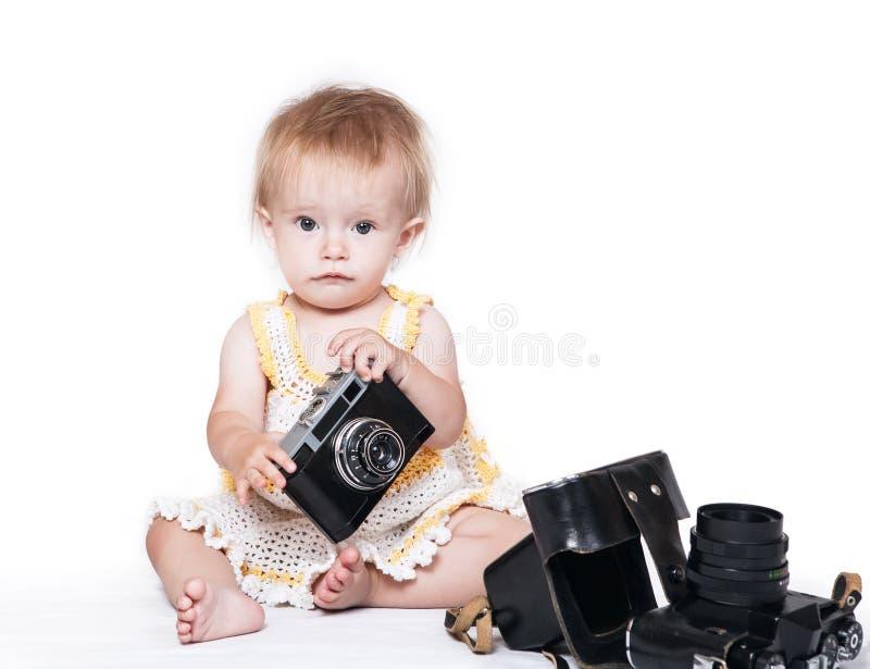 Bébé mignon avec le rétro appareil-photo de photo images libres de droits