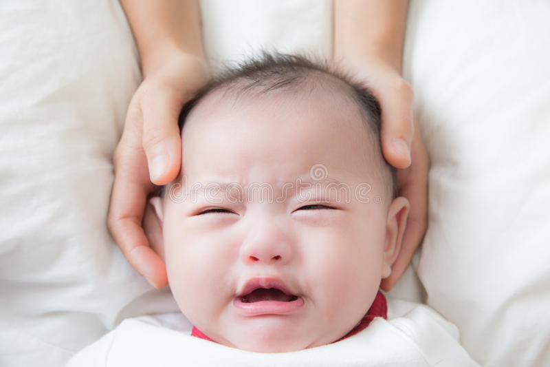 Bébé pleurant photo stock