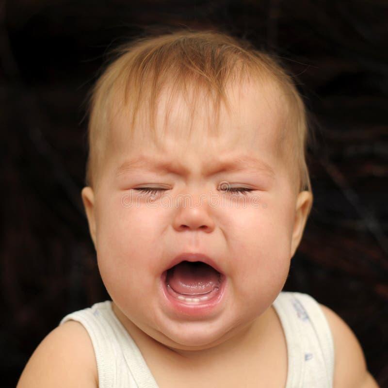 Bébé pleurant très avec émotion photographie stock