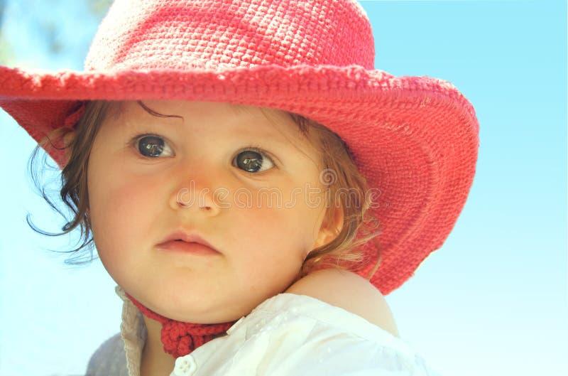 Bébé rouge de chapeau photographie stock