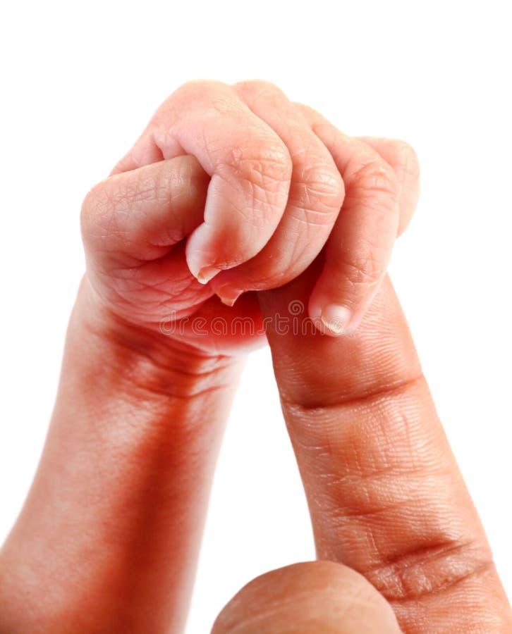 Bébés main et doigt photo stock