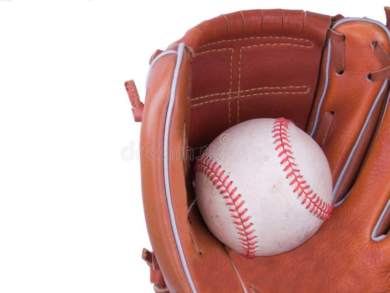 Béisbol que es cogido en un guante de béisbol fotografía de archivo