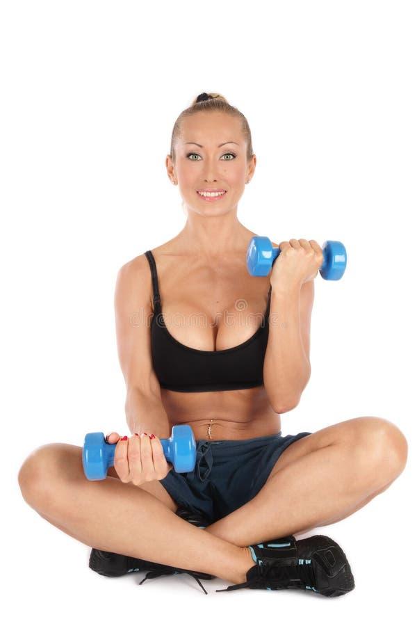 Bíceps do treinamento fotografia de stock