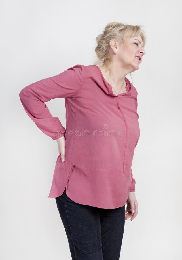 ból pleców kobieta obrazy stock