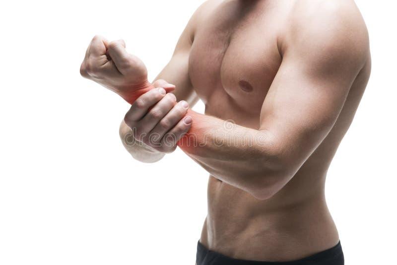 Ból w ręce buck mięśni ciała Przystojny bodybuilder pozuje w studiu Odizolowywający na białym tle z czerwoną kropką obrazy stock
