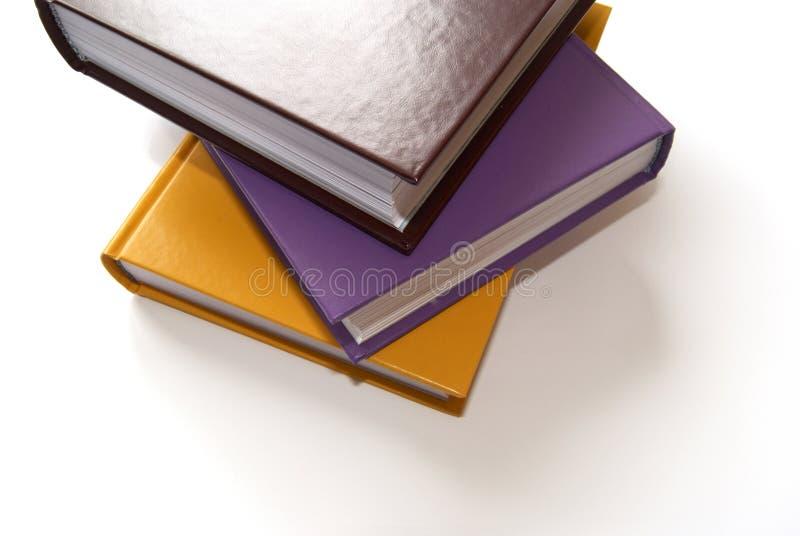 böcker färgade mång- tre royaltyfria bilder