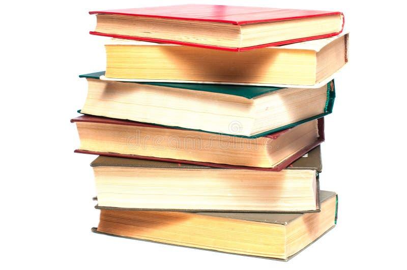 böcker som isoleras över buntwhite royaltyfri foto