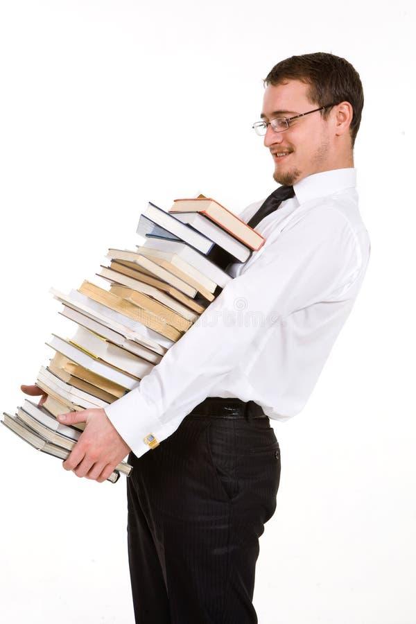 böcker som rymmer manbunten ung royaltyfri fotografi