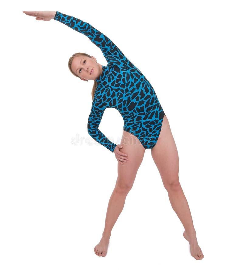 böjande gymnastsida arkivbilder