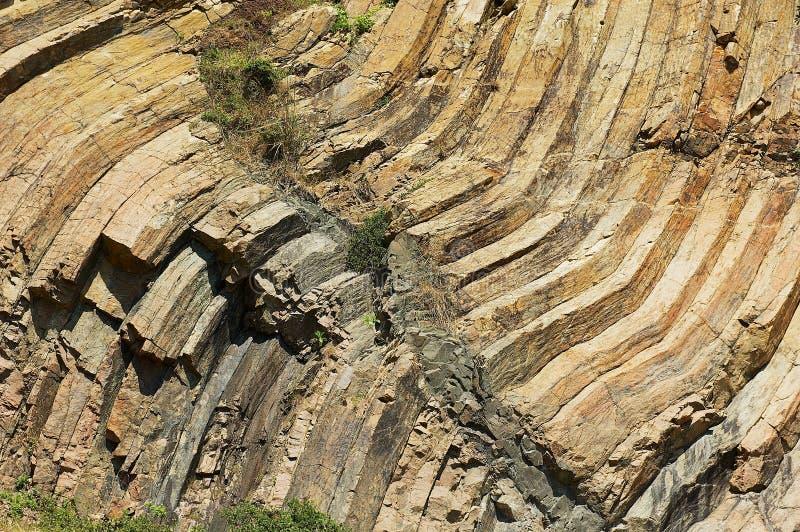 Böjde sexhörniga kolonner av det vulkaniska ursprunget på Hong Kong Global Geopark i Hong Kong, Kina royaltyfri fotografi
