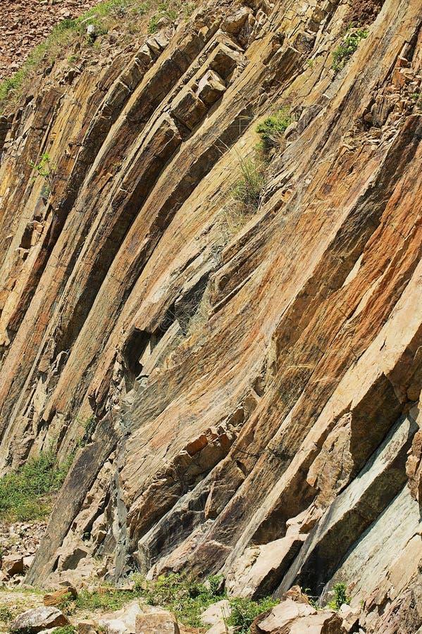 Böjde sexhörniga kolonner av det vulkaniska ursprunget på Hong Kong Global Geopark i Hong Kong, Kina arkivbild