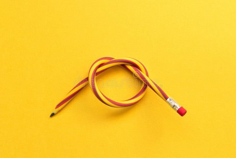 böjlig blyertspenna Isolerat på gul bakgrund royaltyfria bilder