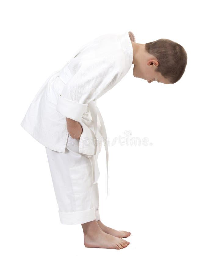 Böjningspojke i judokimono, arkivbild
