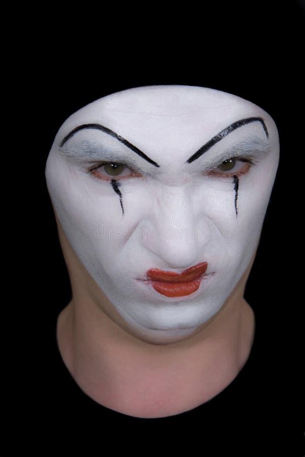 Böswilliger Pantomime auf schwarzem Hintergrund stockfoto