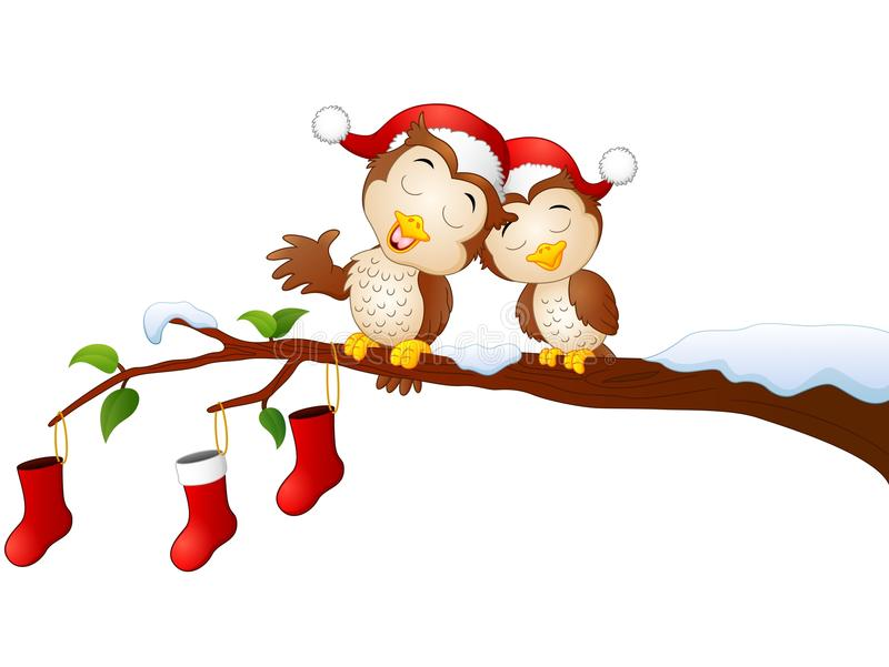Búhos de los pares de la Navidad en la rama de árbol con los calcetines de la Navidad ilustración del vector
