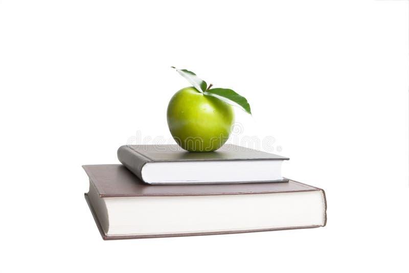 Bücher und Apple stockbilder