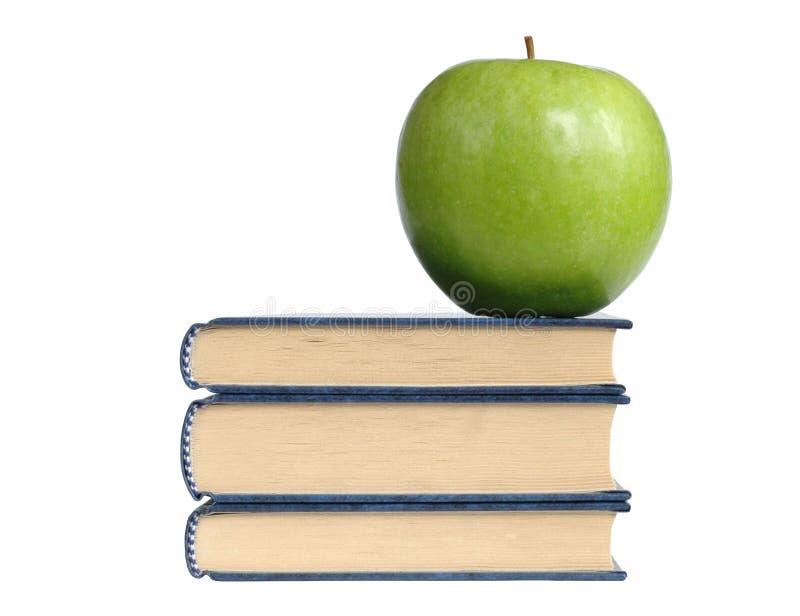 Bücher und grüner Apple lizenzfreie stockfotos