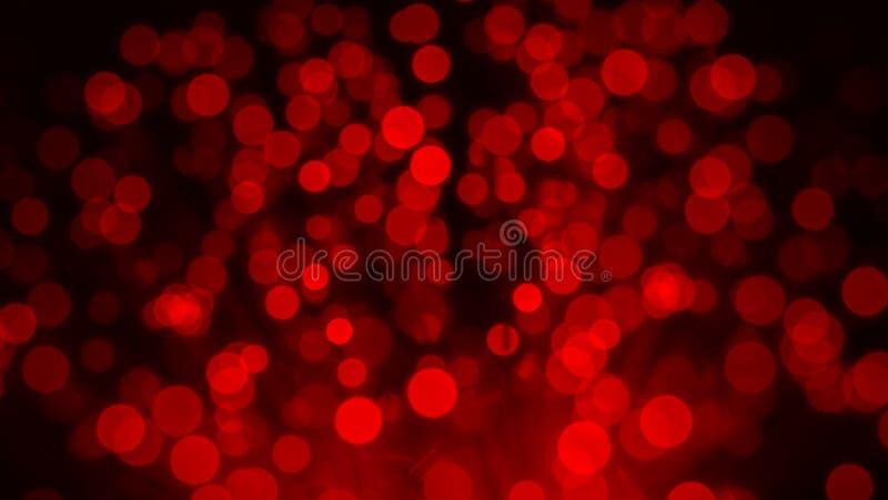 Bündel Optikfasern im roten Licht stockbilder