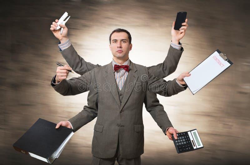 Büroangestellter mit vielen Händen lizenzfreie stockfotografie
