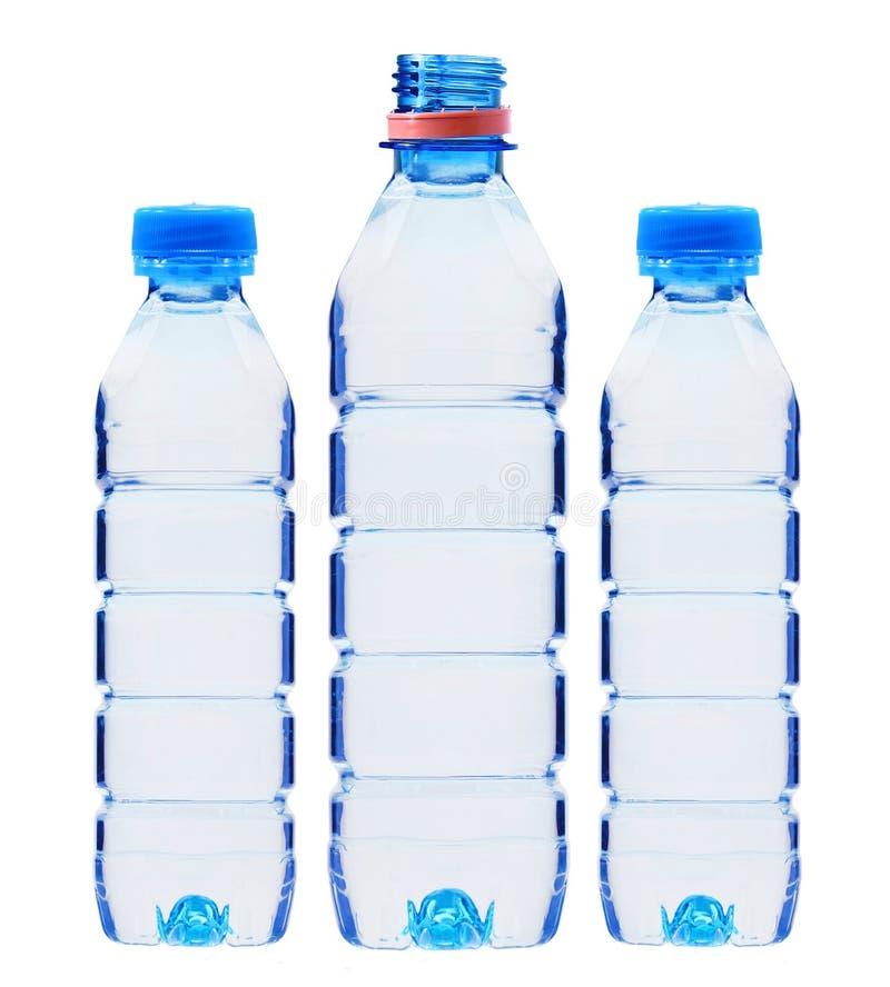 Błękit butelki z wodą odizolowywającą na bielu fotografia royalty free