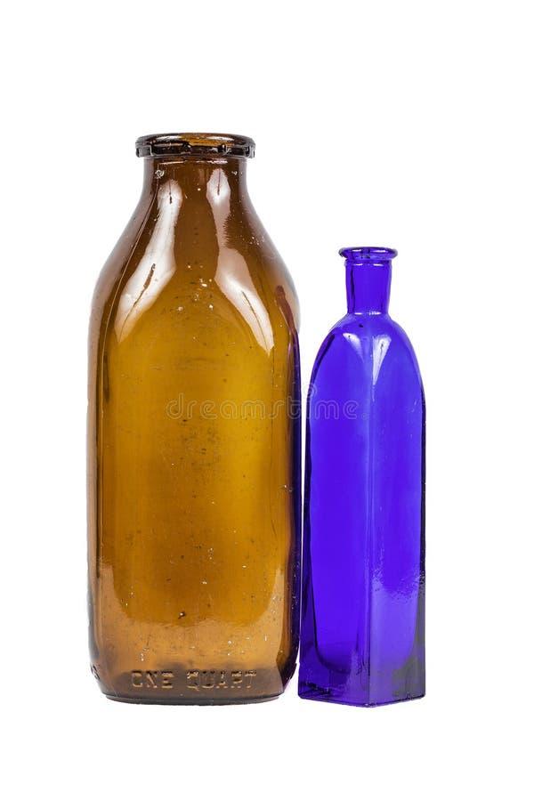 Błękit i Brown Szklane butelki Odizolowywać zdjęcie royalty free