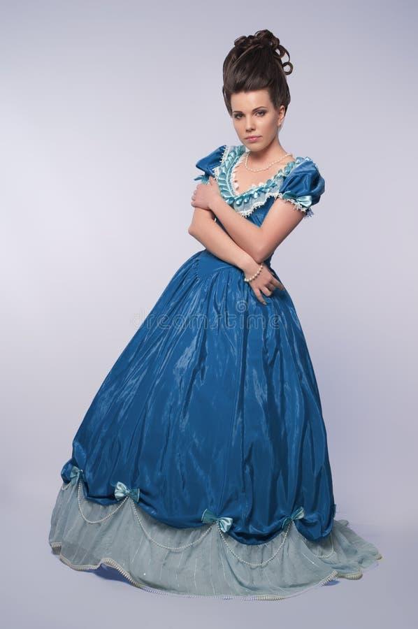 błękit suknia fasonował dziewczyny starej zdjęcia stock