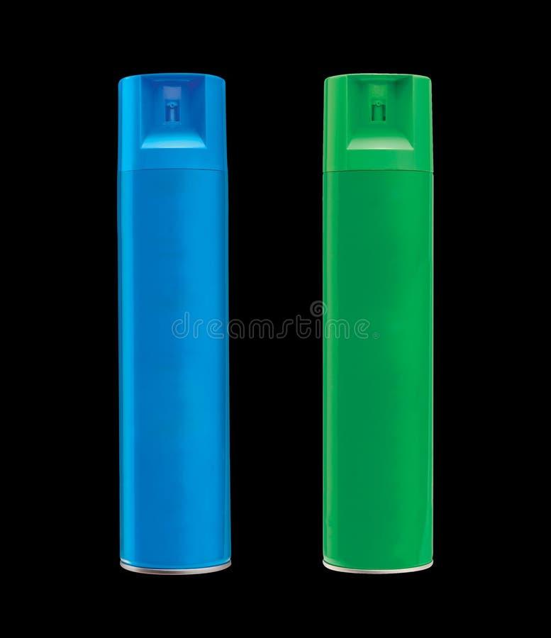 Błękita i zieleni kiści butelki, odosobnione na czarnym tle fotografia royalty free