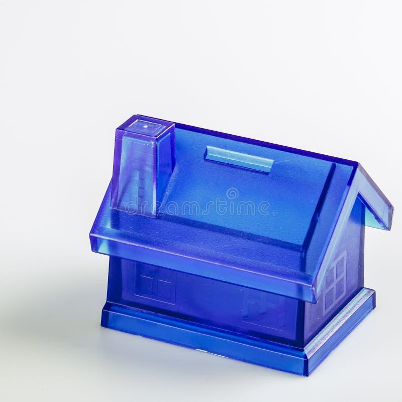 Błękita pieniądze Domowy pudełko na Białym tle zdjęcia stock