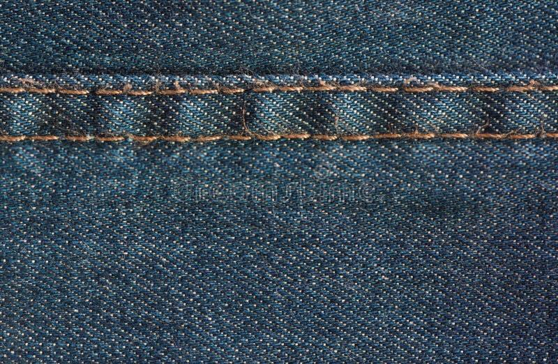 Błękitna drelichowa cajg tekstura z szwem, tło obrazy stock