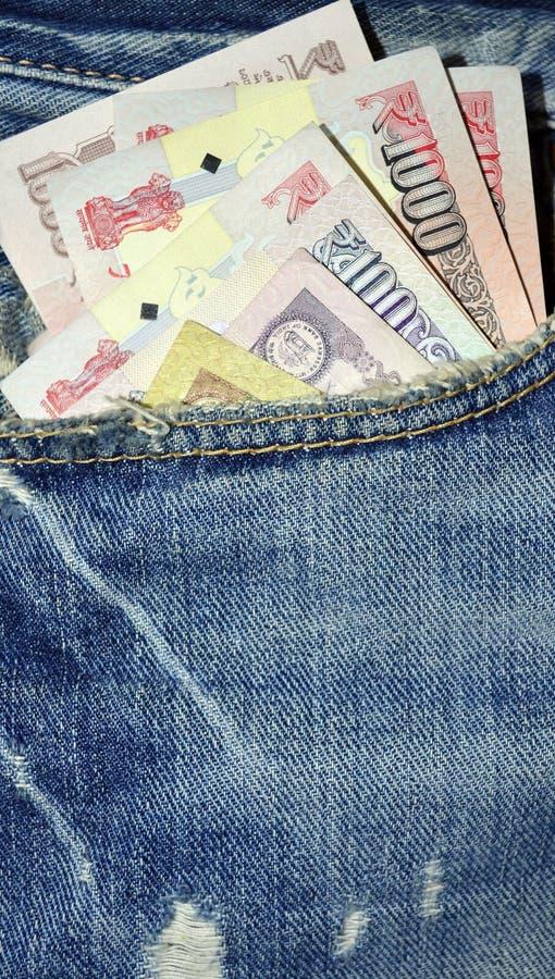 Błękitna koloru drelichu kieszeń z Indiańskim pieniądze zdjęcie royalty free