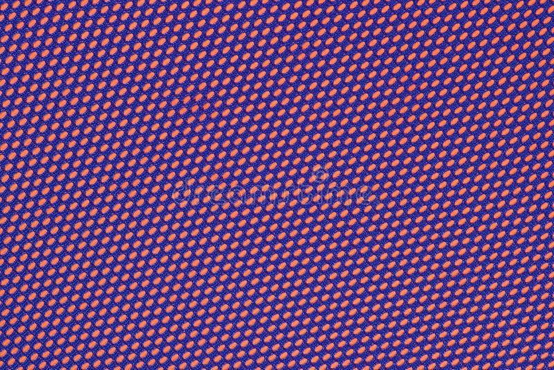 Błękitna nonwoven tkanina na pomarańcze fotografia stock