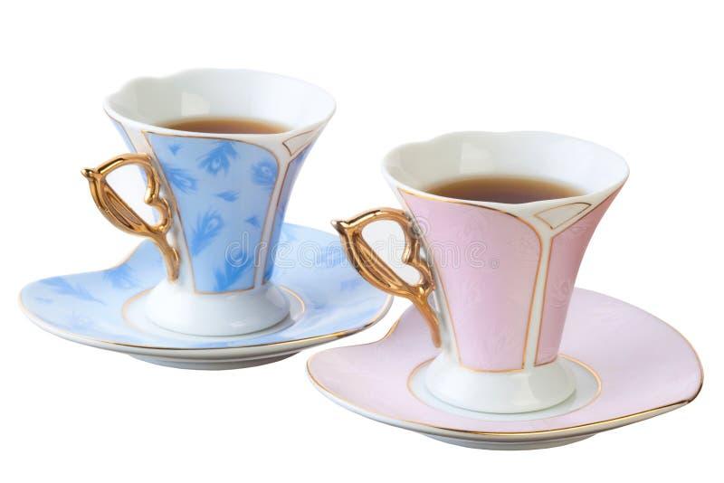 Błękitne i różowe filiżanki. zdjęcia royalty free