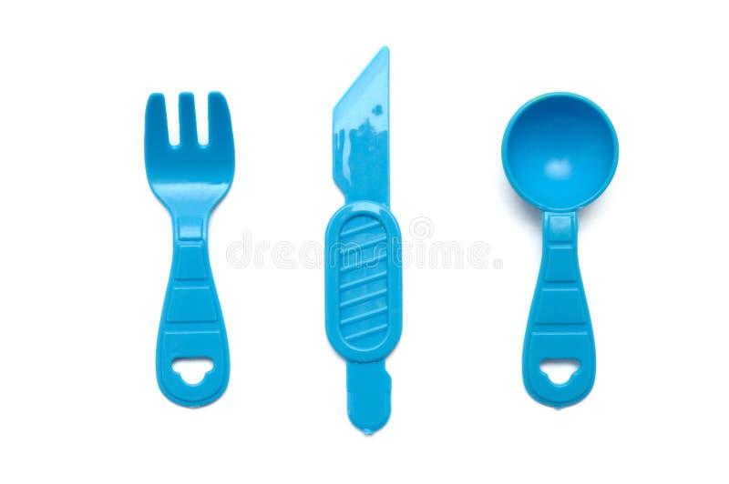 Błękitne plastikowe zabawki rozwidlenie, miarka i nóż, fotografia stock