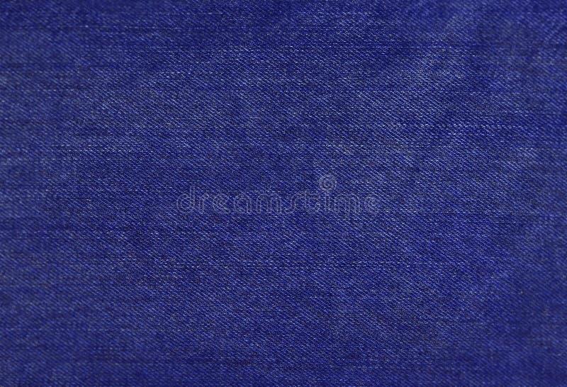 Błękitnego jeanss tła cajgów tekstury cajgów Błękitny drelichowy tło ilustracji