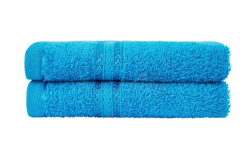 Błękitni kąpielowi ręczniki w stercie t?a ?cinku odosobniony lifebelt nad ?cie?ki biel obrazy royalty free