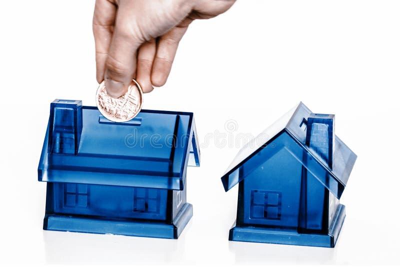 Błękitni pieniędzy pudełka - dom obrazy stock