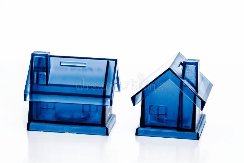 Błękitni pieniędzy pudełka - dom obraz stock