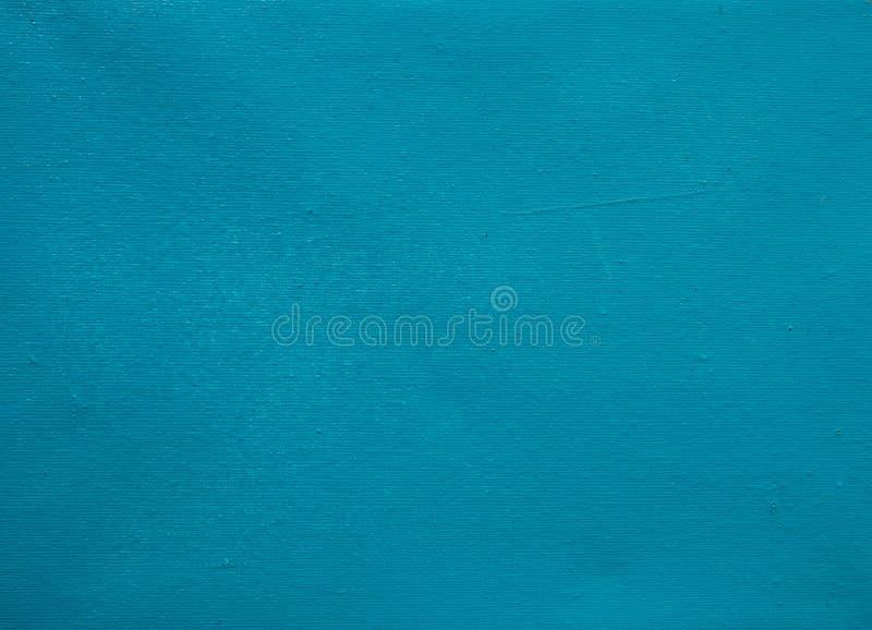 Błękitny brezentowy tło Nadużyta brezentowa szorstka tekstura Błękitna cyraneczka malował kanwę dla marynarka wojenna sztandaru s fotografia stock