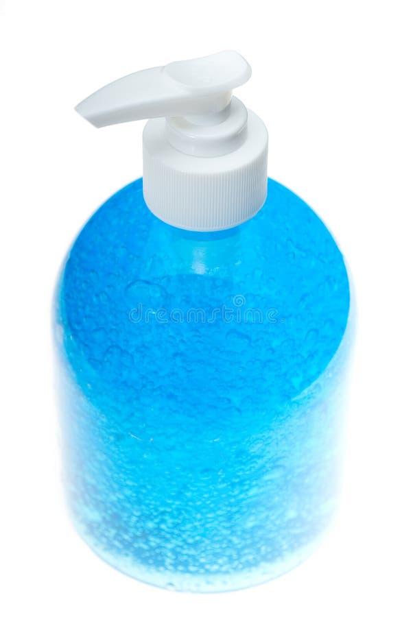 błękitny butelki gel włosy nad biel zdjęcia royalty free
