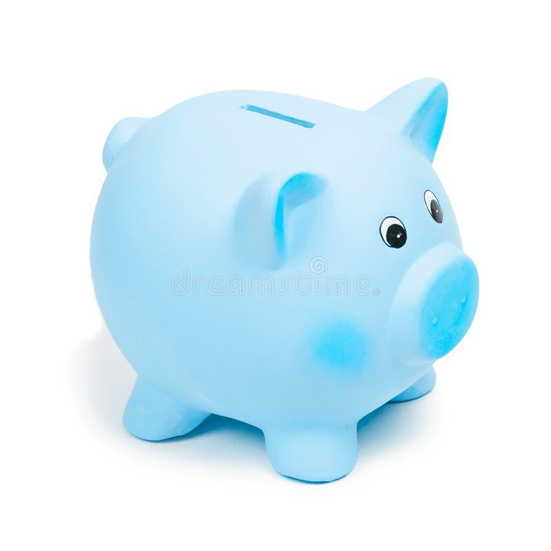 Błękitny ceramiczny prosiątko bank na białym tle, odosobniony obrazy royalty free