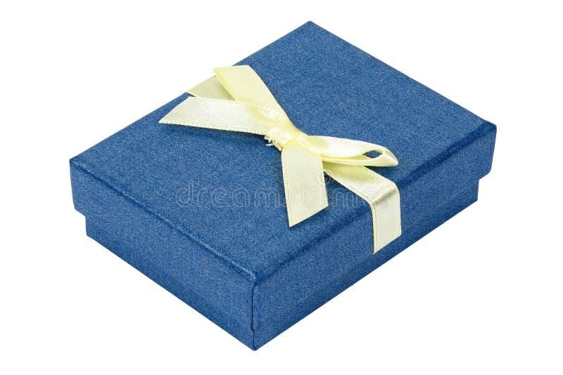 Błękitny dekoracyjny teraźniejszości pudełko z żółtym faborkiem zdjęcia royalty free