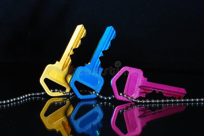 błękitny kluczy różowy kolor żółty obraz stock